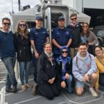 Ashland Wisconsin Express participants learn about Coast Guard rescues off the coast of Madeline Island, Wisconsin.